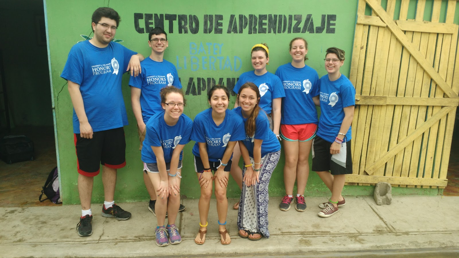 University of Delaware student group pose in front of the Batey Libertad Learning Center.